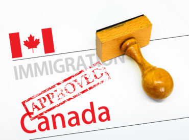Approved Immigration Canada application form with rubber stamp